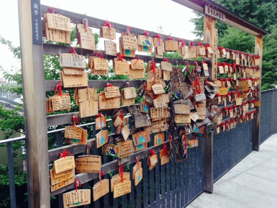 Lots of Japanese Ema, small wooden plaques for prayers